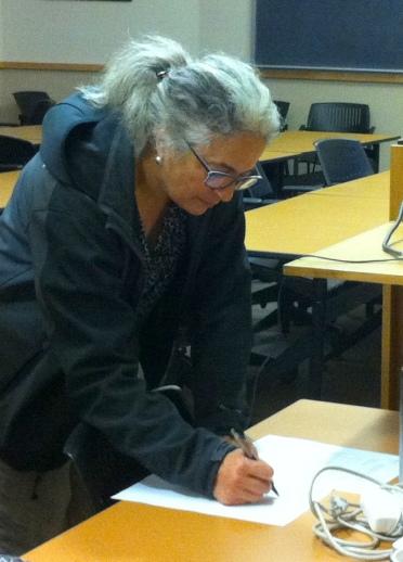 Committee member Dr. Carla D'Antonio signing