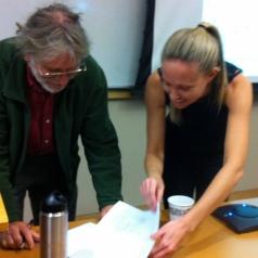 Committee member Dr. Dar Roberts signing