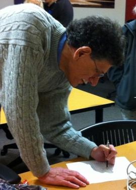Advisor Dr. Josh Schimel signing