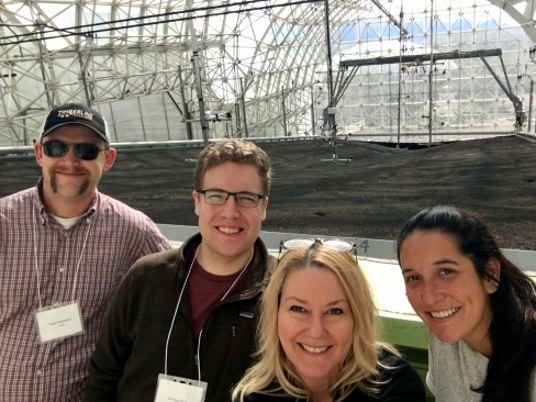 Ryan Niemeyer, Will Burke, Janet Choate, and Rachel Torres in front of one of the experimental hillslopes inside the LEO